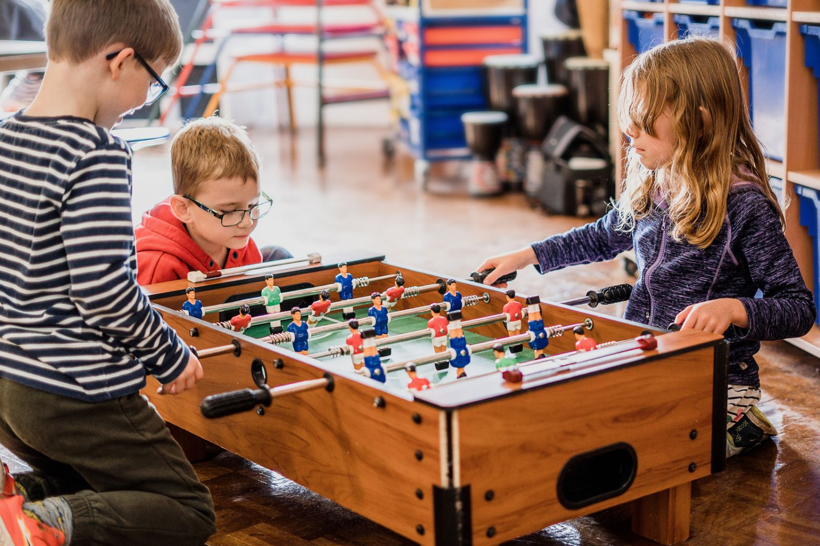 childen playing table football at a oxfordshire school holiday club